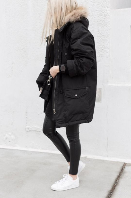 Oversized black parka and sneaks.