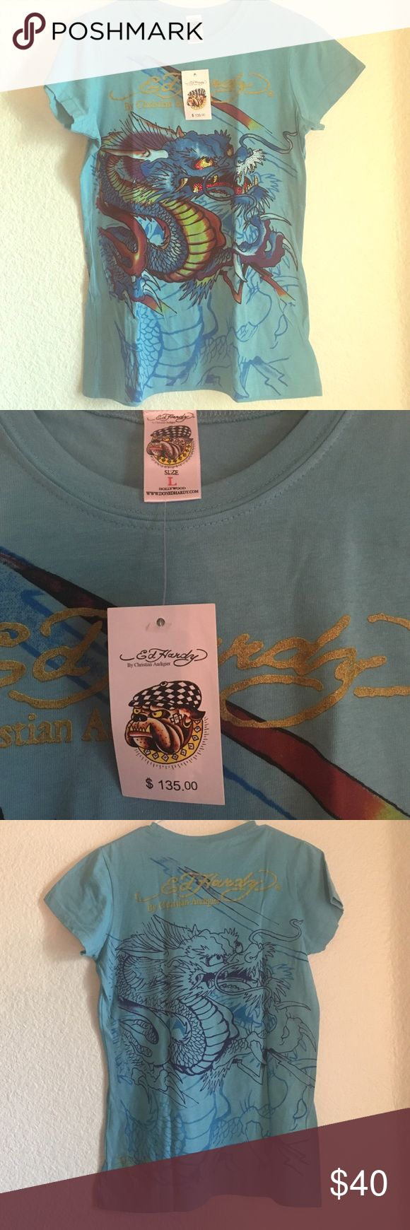 *NEW WITH TAGS* women's blue Ed Hardy tshirt, SZ L *NEW WITH TAGS** never been worn, blue Ed Hardy t-shirt, size Large! A friend of mine had a bunch left over from an old store and gave them to me to sell so price is def negotiable! Ed Hardy Tops Tees - Short Sleeve