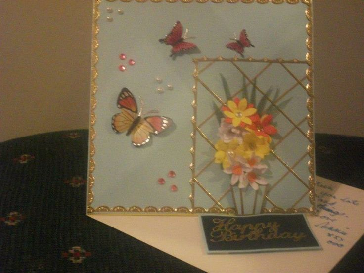 Paper flowers on a easel card.