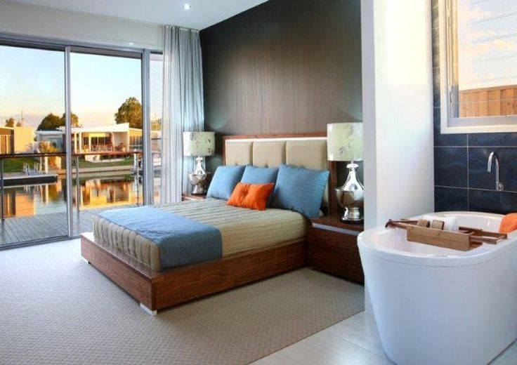 Master Bedroom. High Bath Tub. Bed board. Lamps. Cushions. G.J. Gardner Homes Australia.