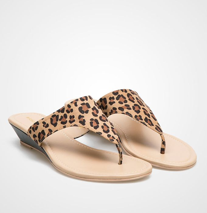 Leopard Wedge sandals by Nicholas Edison. Keep yourself comfortable and stylish in these wedge sandals with glam leopard pattern. It suits your afternoon daily outfit.  IDR. 237.000