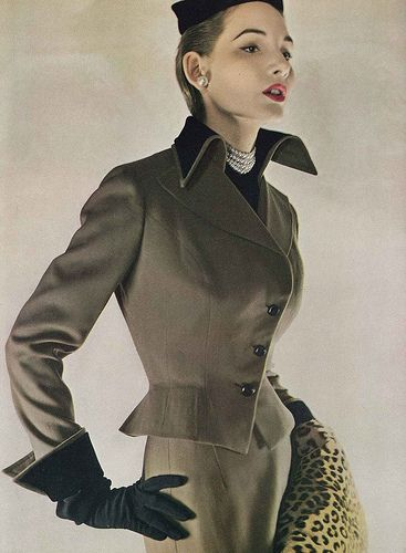 August Vogue 1949. high collar, gauntlet gloves in black, grey suit