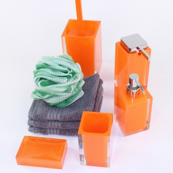 Rainbow Orange Bathroom Accessory Set  Rainbow Orange Bathroom Accessory Set includes:    Soap dispenser  Large soap dispenser  Soap dish  Toothbrush holder  Toilet brush    Made of out thermoplastic resins with a orange finish.