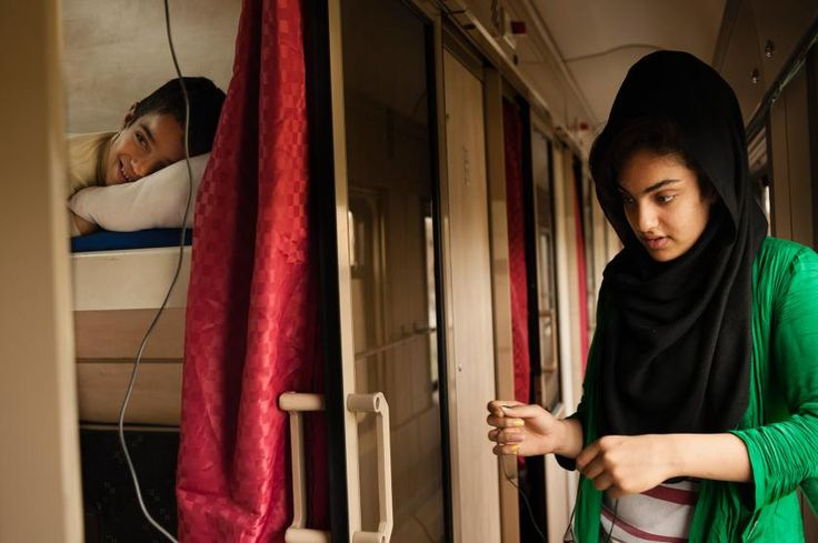 Mozhdeh, 15, and her eight year old brother spend time in their cabin on the TransAsia train that goes from Tehran to Ankara. They are both equally saddened and confused by their parents' decision to flee the country and become refugees in Turkey. Eastern Azerbaijan, Iran, April 4, 2013.