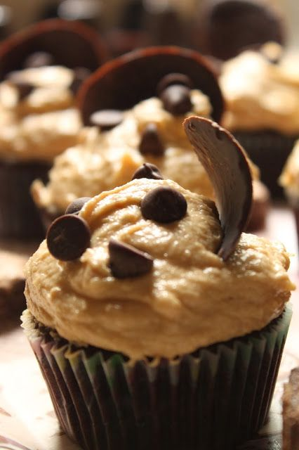 Dark cuppies with peanut butter buttercream frosting