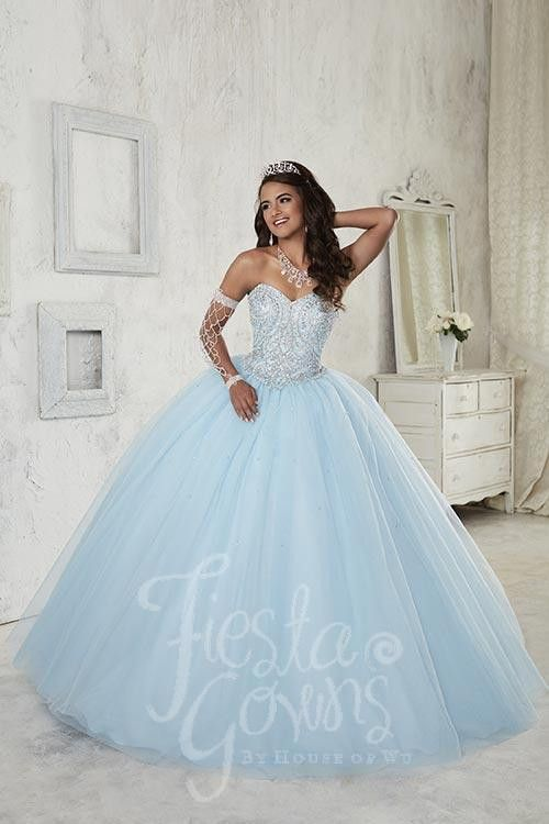 Tulle ball gown with shining beaded strapless bodice and beads trickling down the full skirt. Lace-up back. Download the Fiesta Gowns by House of Wu sizing chart here. *Note lead times for dresses wil