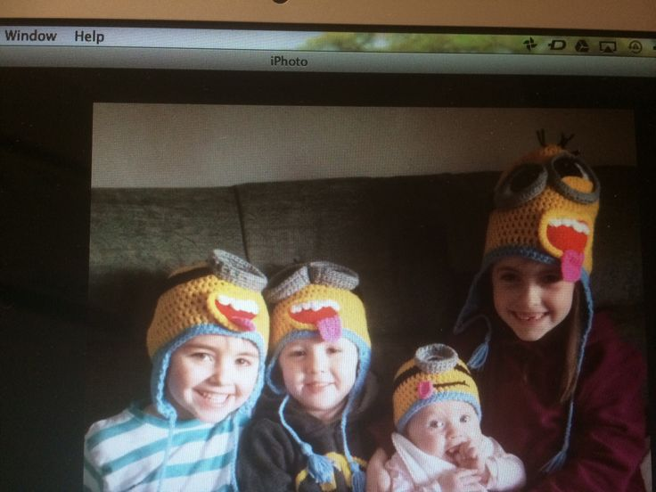 The four terriers modelling their minion crochet hats...