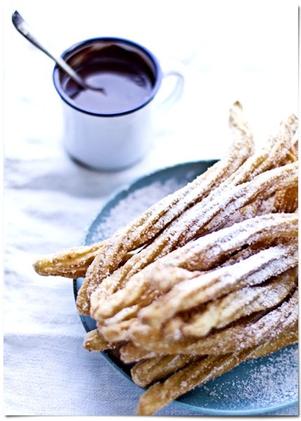 Churros con chocolate :o)  I cringed when I read Nutella but it's nutella turned into the sweet think chocolate you need with churros. (Unlike the slab of pure nutella some people use with churros)