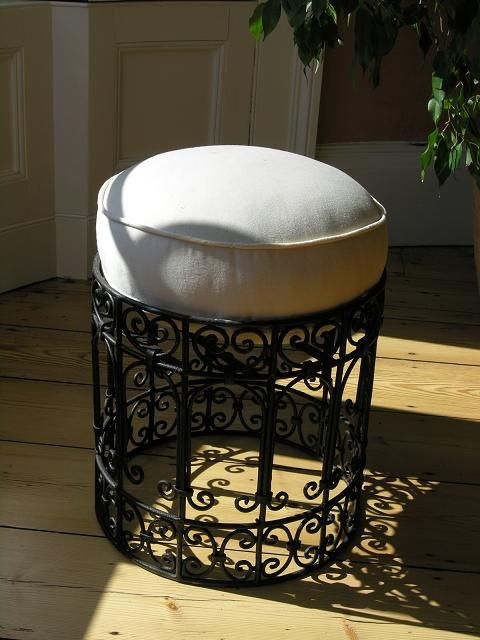 Moroccan wrought iron stool with cream canvas cushion. http://www.maroque.co.uk/showitem.aspx?id=ENT01387&p=01571&n=all