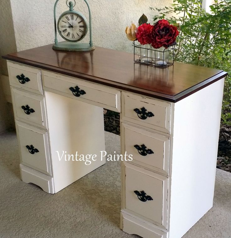 Old desk found at a thrift store got an update!  Painted Creamy by Sherwin Williams, with a Java Gel Stain top and distressed.