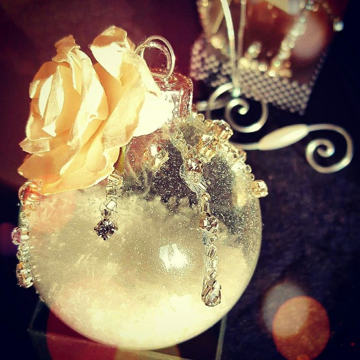 Glass christmas ornament .... with snow ...rhinestones and paper rose