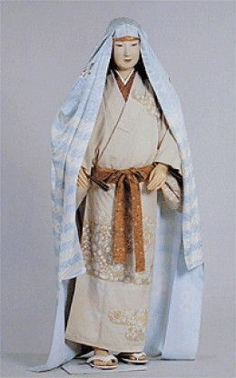 An example of a classy Muromachi Period lady, wearing a katsugu on her head and a patterned narrow obi.