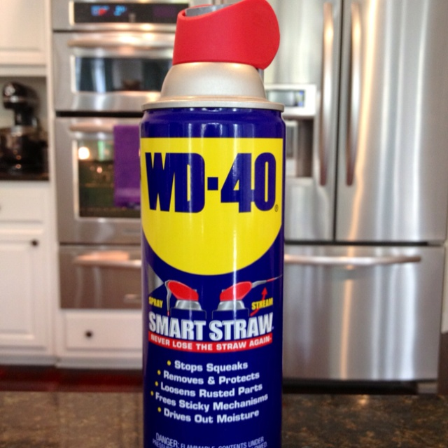 Use WD-40 and a soft cloth to clean stainless steel appliances and fixtures.   Just spray a small amount directly onto the cloth and wipe the surface WITH the grain. Before allowing to dry, go over with a clean cloth (again WITH the grain) to remove excess WD-40.   Remember: spray directly onto the cloth NOT the surface!! A little bit goes a long way :)   Honestly, WD-40 works a lot better than the solution recommended by the appliance store, lasts longer, and is less expensive.