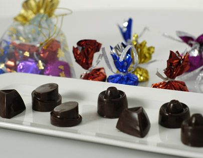 Moulded chocolate and chocolate rocks made with a filling of pistachios, raisins, dry fruit chikki and chocolate ganache.