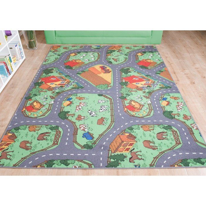 The Farm games carpet invites your child to play for hours. What child does not dream of a holiday on a farm? With this rug your children's wish comes true. The rug allows your kid's to drive their toy tractor around the farm and along fields where the farmer is harvesting his crops along meadows with cows and horses. The farm carpet offers pure adventure and allows your child's imagination to run wild. The rug is extremely easy to clean and fast to clean. The children's rug h...