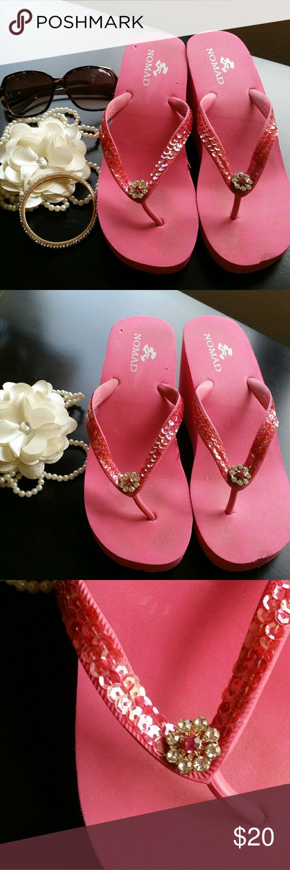 NWOT Platform Bling Flip Flops NWOT Nomad bling platform flip flops. Platforms are 🔥HOT🔥 this season! Never worn, minor dings from storage. Still has stickers on the bottom! Size 8. Platform is 3.5 inches high. Nomad Shoes Sandals