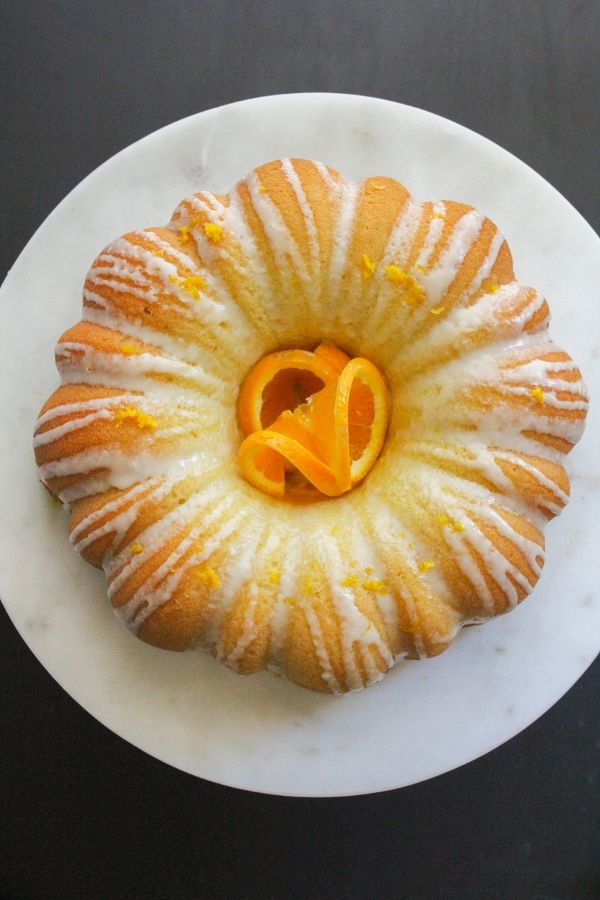 Simple Glazed Orange Bundt Cake | The Chef Next Door.  This Simple Glazed Orange Bundt Cake is full of delicious citrus flavor and is perfect for  dessert, afternoon tea, and even breakfast!