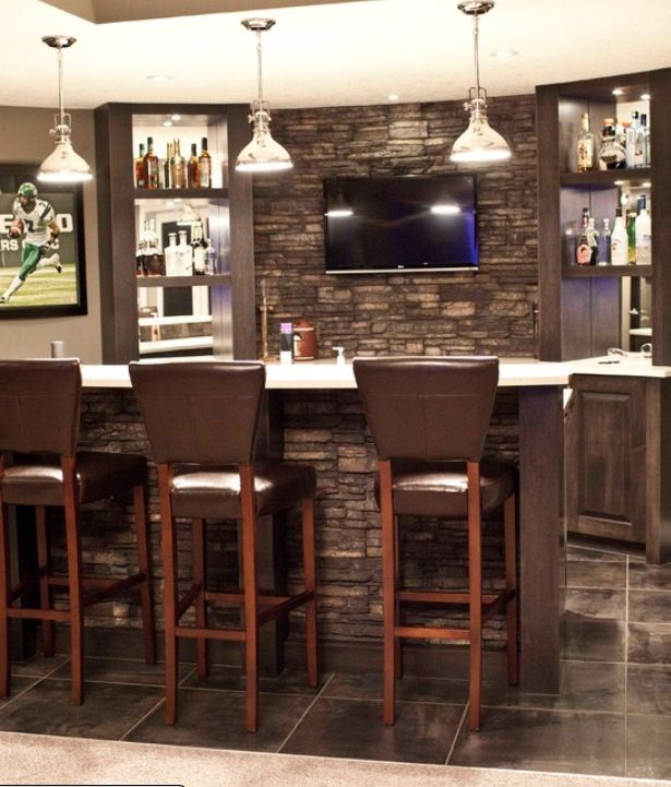 Stone wall behind the bar | Refinished basement ...