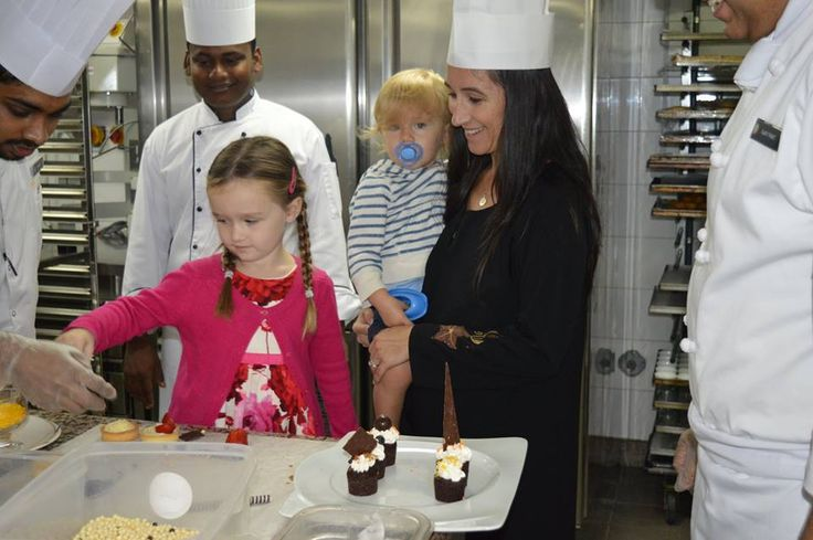 We would like to share Chef Ajay Pant's success story who found Mrs. Downer and the kids joining us daily for the breakfast in Twist restaurant.. Juliet Downer was making cakes on her I-Pad while having breakfast...  Chef approached them and invited them to the pastry kitchen to make the cupcakes in real and the family (Mrs. Downer, Little Juliet and James) really enjoyed... Juliet was so proud of her creations while showing to her dad later...