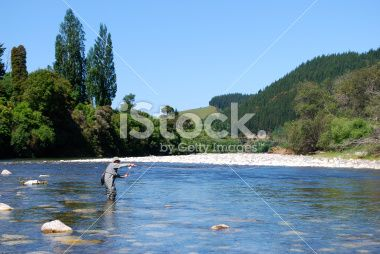 Fisherman on the Motueka River, Tasman, New Zealand Royalty Free Stock Photo