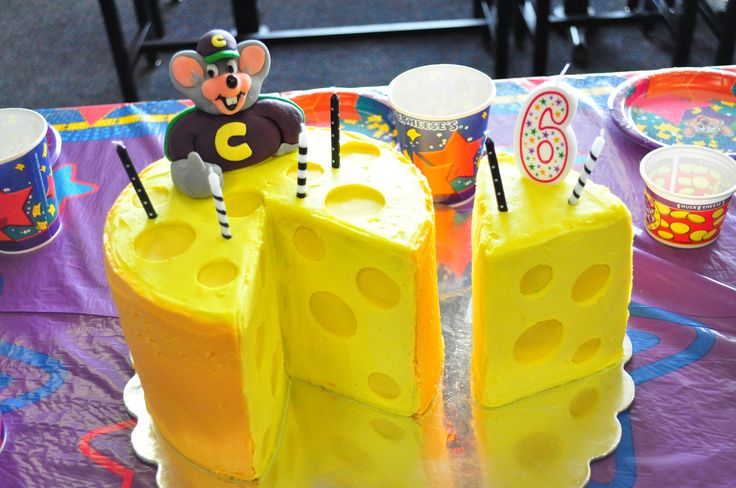 """Chuck E. Cheese """"cheese cake"""" Buttercream and fondant icing with fondant modeled Chuck"""