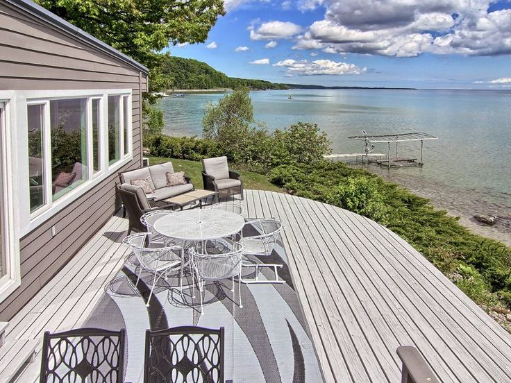 Week just Opened Up!  August 27-Sept 1. This beautiful home has a unique and incredible setting off of the famous M-22 on it's own private peninsula of matu...