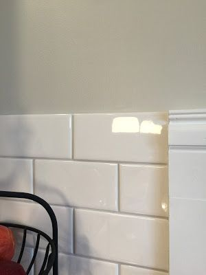 Subway tile with warm gray grout. SW Agreeable gray wall color.
