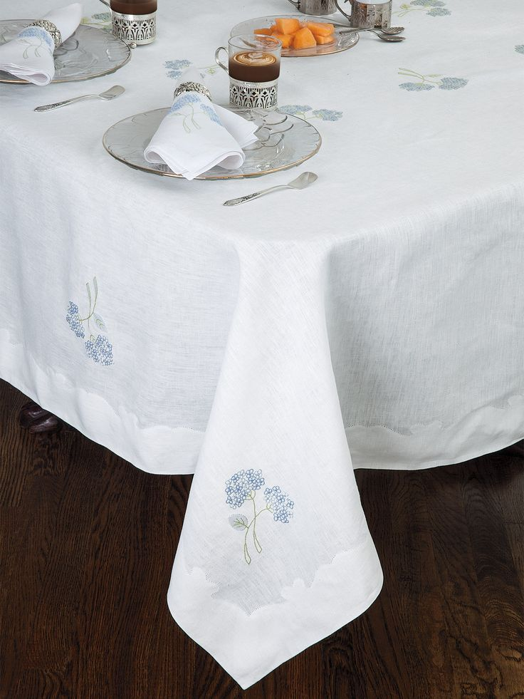 Hydrangea Table Linen - Fine Table Linens - Schweitzer Linen  Food simply tastes a whole lot better when served on these lovely table linens. Hand embroidered with pastoral Blue and Green Hydrangeas and inverted scallops on the border. Made of 100% White Italian linen.