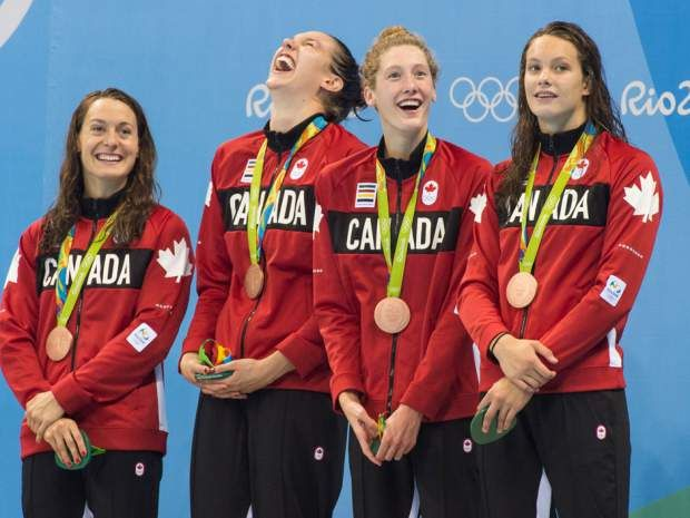 Canada's first medal in Rio 2016: Young swimmers (Sandrine Mainville of Boucherville, Que., Winnipeg's Chantal Van Landeghem, Taylor Ruck of Kelowna, B.C., and Toronto's Penny Oleksiak) break through to claim bronze in freestyle relay - by Rob Longley, Postmedia News - The Canadians finished third in three of the four legs of the relay, including the money one for the medal. (Photo credit: Tyler Anderson / Postmedia Network)