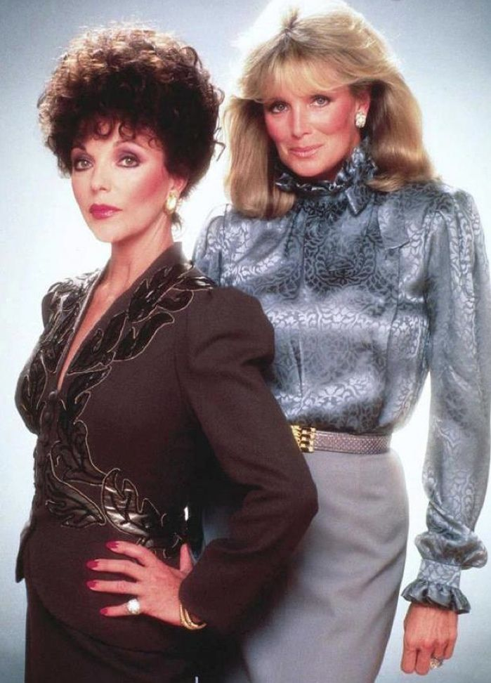 Joan Collins and Linda Evans show off 1980s power dressing in a 'Dynasty' promotional image.