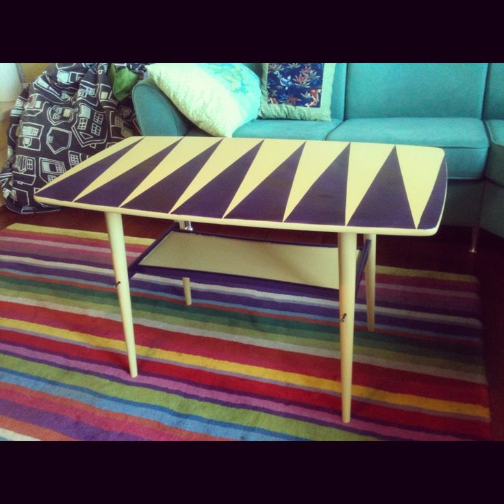A coffee table which I painted yellow and purple-metallic.