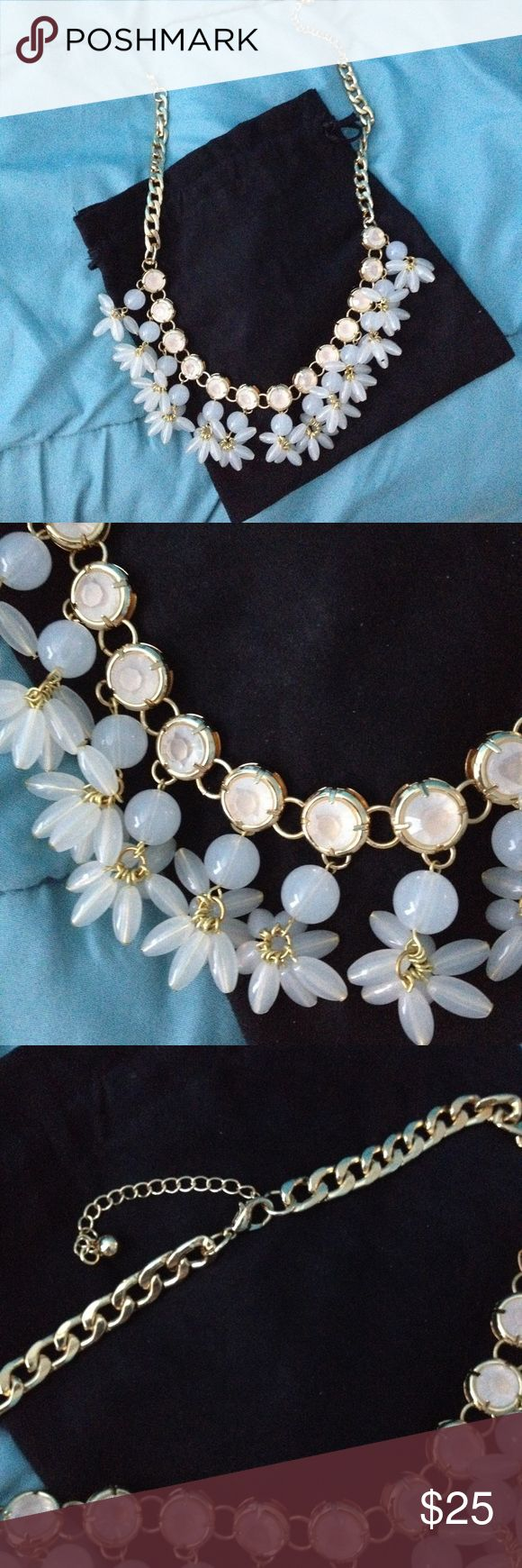"""Statement Necklace Gorgeous statement necklace with gold-tone chain link design, faint cream/gold colored round jewel pieces, and dangling milky white colored flower-type design. Necklace measures 19.5"""" laying flat, with additional 2.5"""" adjustable length lobster clasp closure (photo 3). Comes in a black Baublebar dustbag. Gently used condition with minor wear. Photo 4 shows necklace worn on longest link. ***** This is NOT J. Crew.***** Tagged because of similar style. J. Crew Jewelry…"""
