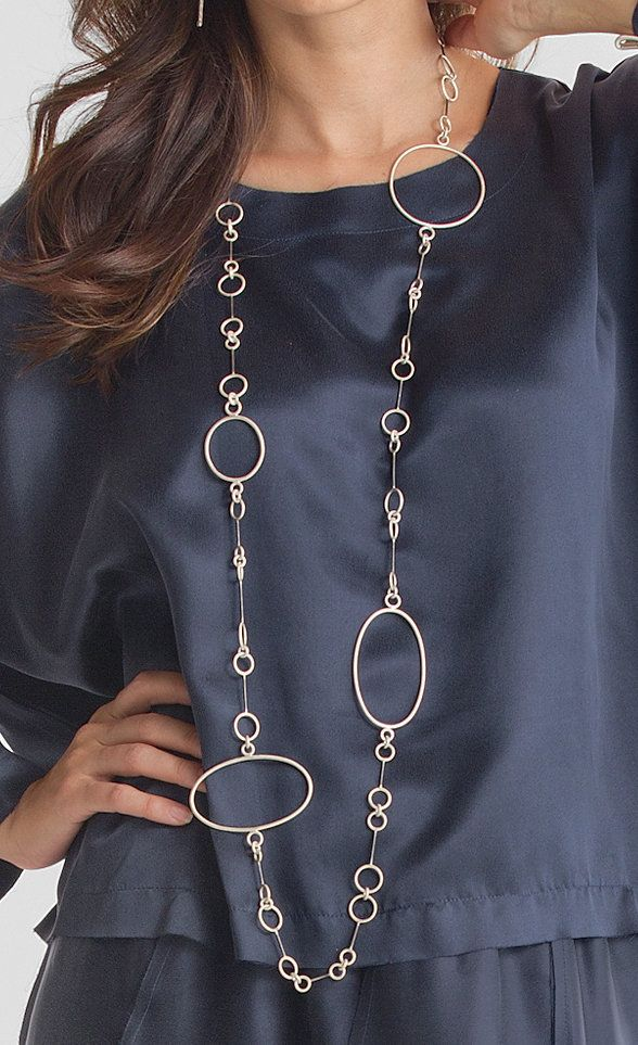 Large Link Necklace by Donna D'Aquino. Entirely hand-fabricated, this dramatic necklace has an asymmetric arrangement of large, sterling silver ovals and smaller steel elements. It can be worn long, doubled over, or even as a belt. Sterling silver toggle closure.
