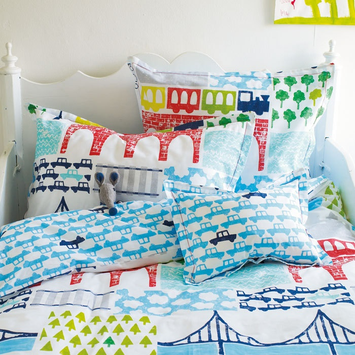Childrens bed linen featuring trains, buses, cars and bridges