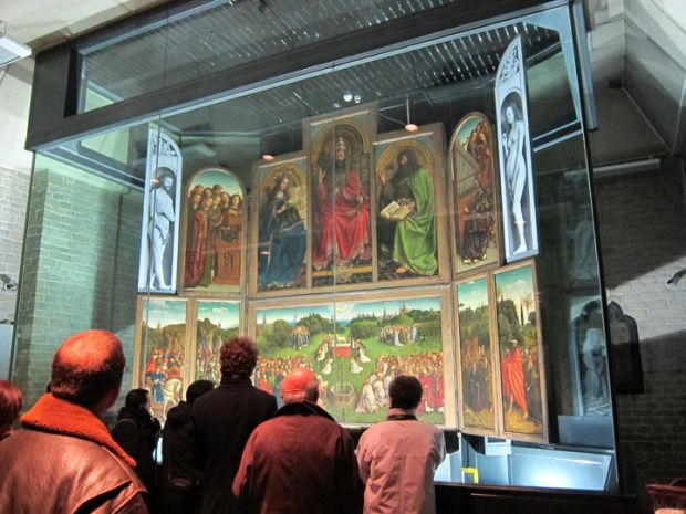 The Ghent Altarpiece in situ. The Adoration Of The Mystic Lamb - by Hubert & Johannes Van Eyck (Belgian, 1430-1432). One of the 10 most important masterpieces of all time. By Christina @ Daydream Tourist. This picture was only possible because the guard left the chapel for a moment to answer a phone call!