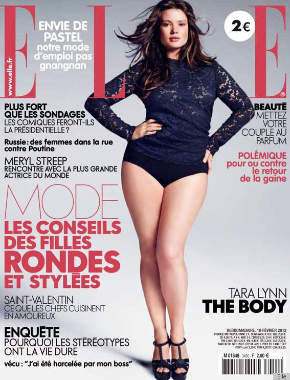 """The French magazine features plus-size model Tara Lynn, who's wearing a lace tee, heels and not much else, on its February cover, and they've dubbed her in bold letters """"The Body.""""  No disrespect to Elle M., but we're kind of loving it."""