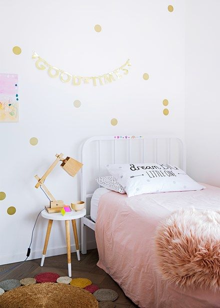 Pops of colour brighten up a little girl's bedroom, thanks to an Armadillo & Co rug and linen from Muji and Adairs | Home Beautiful Magazine Australia