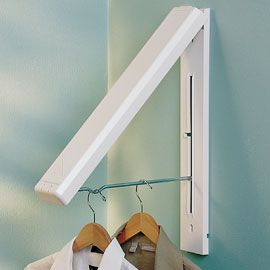 """Fold Away Hanger: InstaHanger Rod Create 12"""" of hanging space that hides away when not in use. This fits in a narrow slice of wall and opens out to 12"""" of hanging space. Perfect for hanging laundry or a rain coat & closes up when you're not using it"""