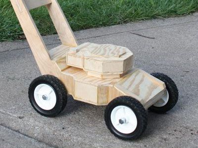The origin of my homemade lawnmower. Started with birch plywood and a set of wheels.