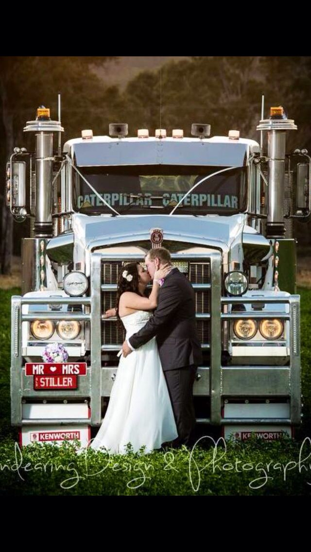My husband loves his kenworth truck.. we had to get this pic on our wedding day!