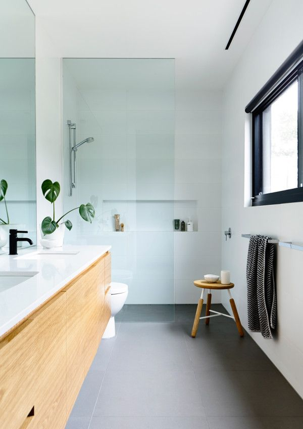 Bright and airy, frame less shower screen no need for shower tray which helps room flow. Timber makes nice contrast. Double vanity.