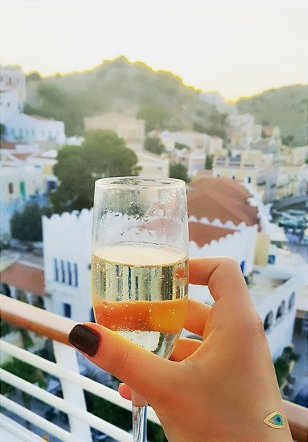 You know it's time to celebrate with a glass of champagne when Symi appears in the horizon! Happy cruise weekend!  Thank you ipek.aydar  #Celestyalcruises #Symi #Greece #island #champagne #luxury #class #cruise #travel #destination #summer