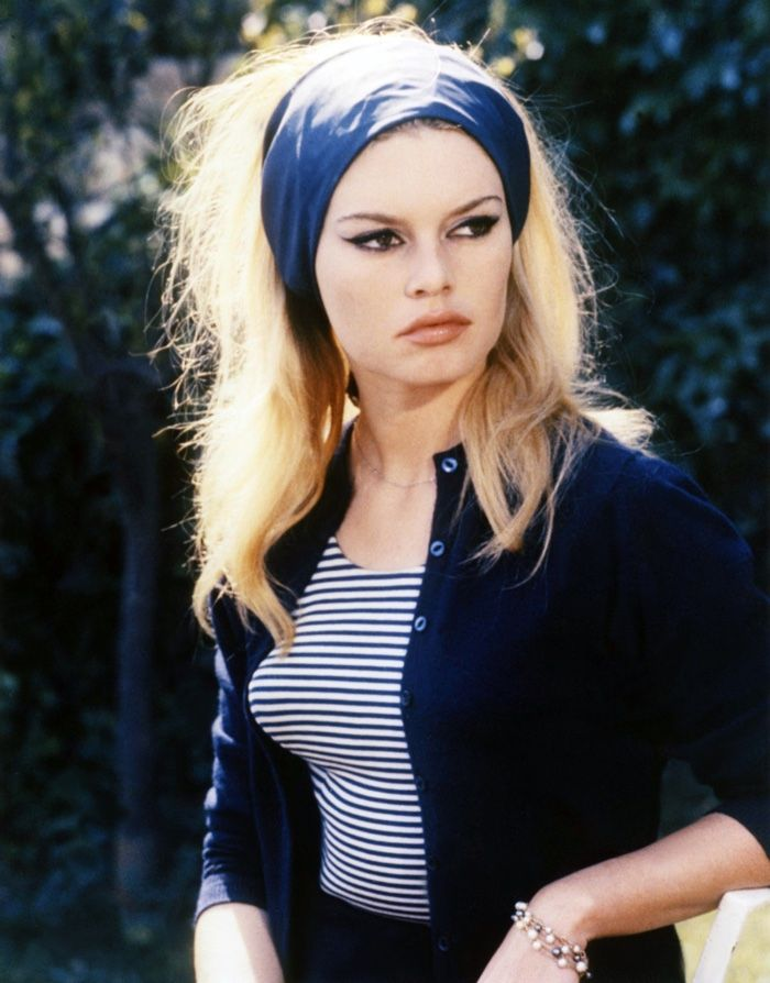 Brigitte Bardot wears cardigan sweater, striped shirt and headband in Contempt still