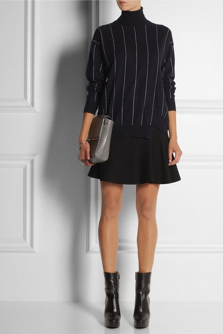 Sweater: STELLA MCCARTNEY €845 Skirt: ALEXANDER MCQUEEN skirt €460 Boosts: STELLA MCCARTNEY €725 Bag: MAISON MARTIN MARGIELA €1,165
