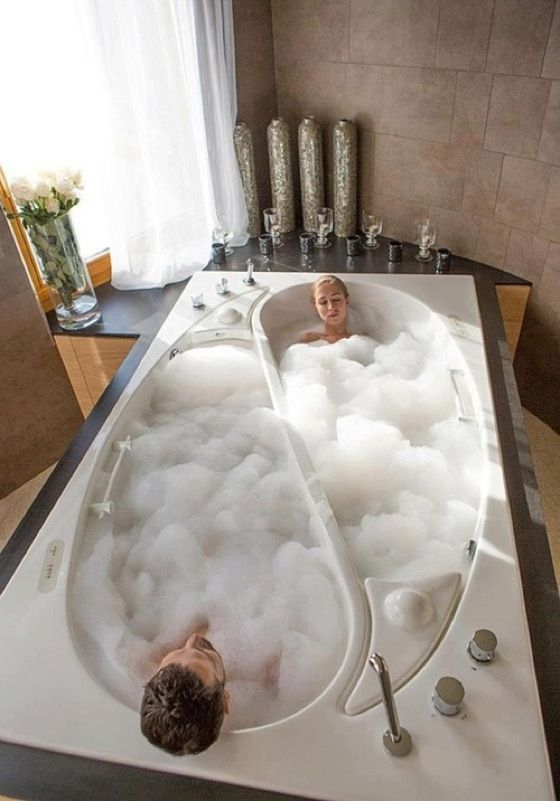 This is the dumbest thing I've ever seen.  If I want someone else taking a bath at the same time I am, I want them IN the same bath I'm in.  And dang it, if I'm alone, nothing would irk me more than seeing half the tub empty...
