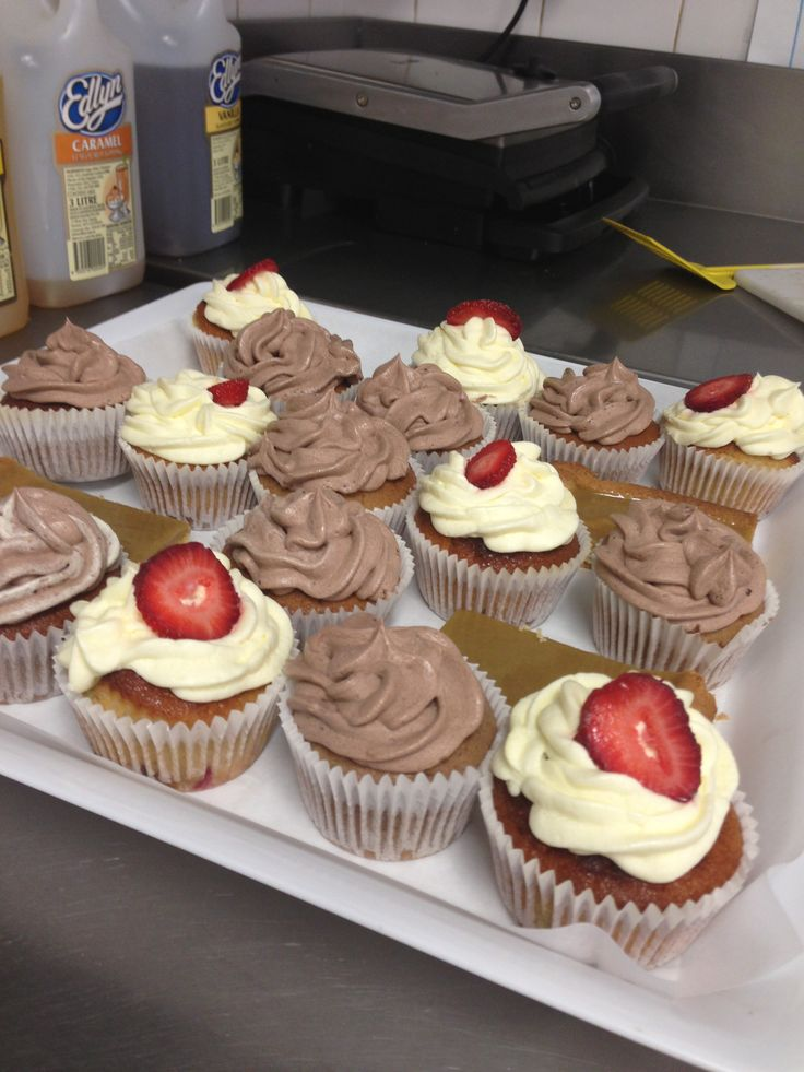 Catering for Shady Lane Cafe. Strawberry cupcakes with vanilla buttercream and chocolate cupcakes with chocolate buttercream! Also ginger crunch :)