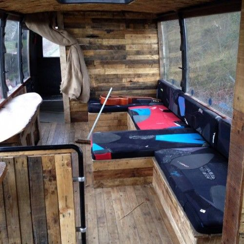 O'Neill Expression Sessions Tour Bus - looks like recyled wood pallettes on walls, floors.