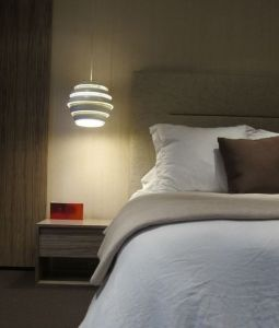 Artek pendant lamp, also known as the Beehive, is made with white painted aluminum