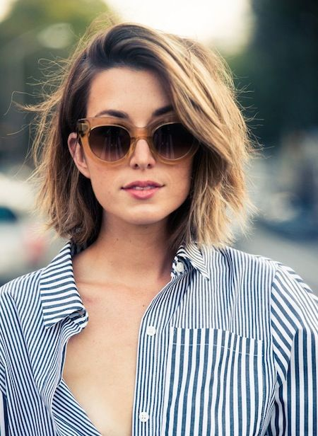Wavy bob cut.  Ends are kinda blunt cut with deep side parted and combed to the side.