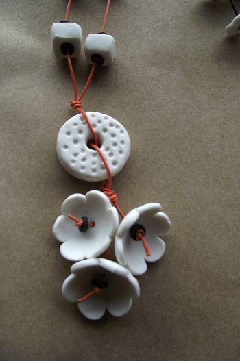 fleurs/perles. I love wind chimes. All your little scraps can be a thing of beauty to the eyes and ears! Make them all shapes and sizes!